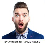 portrait of a young surprised... | Shutterstock . vector #242978659