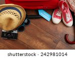 suitcase and tourist stuff with ... | Shutterstock . vector #242981014