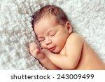 infant sleeps in a dream... | Shutterstock . vector #243009499