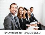 confident businessman sitting... | Shutterstock . vector #243031660