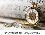 pocket watch against a calendar ... | Shutterstock . vector #243039469