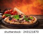 delicious italian pizza served... | Shutterstock . vector #243121870