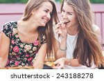 Two Young Female Friends Laugh...