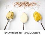 mustard and mayonnaise on spoon ... | Shutterstock . vector #243200896