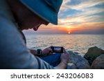 traveler making photo of sunset ... | Shutterstock . vector #243206083