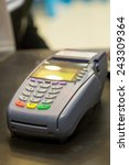 Small photo of Credit Card Machine on cashier counter in the store : Selective Focus
