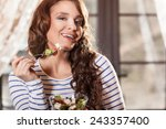 pretty woman eating fresh... | Shutterstock . vector #243357400