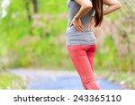 side stitch   woman runner side ... | Shutterstock . vector #243365110