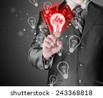 business man touching light of... | Shutterstock . vector #243368818