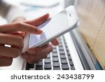 close up of person at laptop... | Shutterstock . vector #243438799