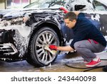 Man Worker Washing Car's Alloy...