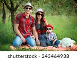 happy young family wearing sun... | Shutterstock . vector #243464938