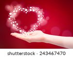 a hand of a young woman gives a ... | Shutterstock . vector #243467470