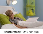 ill little kid taking a nap... | Shutterstock . vector #243704758
