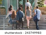Stock photo happy students walking and chatting outside at the university 243749983