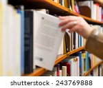 Hand Of Woman Selecting A Book...