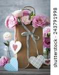 St. Valentines Day background with pink flowers, blue bow and paper and wooden hearts - stock photo