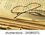 old  religious book and glasses | Shutterstock . vector #24380371