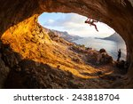 young woman lead climbing in... | Shutterstock . vector #243818704
