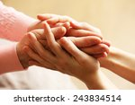 old and young holding hands on... | Shutterstock . vector #243834514