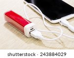 smartphone charged by power... | Shutterstock . vector #243884029