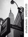 Small photo of Street signs and Empire State Building B&W