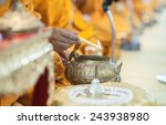 close up monk do holy water in... | Shutterstock . vector #243938980
