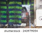 grey car during washing process | Shutterstock . vector #243979054