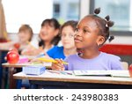 row of students in a primary... | Shutterstock . vector #243980383