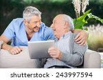laughing male caretaker and... | Shutterstock . vector #243997594