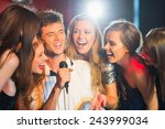 happy friends singing karaoke... | Shutterstock . vector #243999034