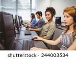happy student in computer class ... | Shutterstock . vector #244003534