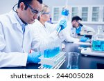 science student using pipette... | Shutterstock . vector #244005028