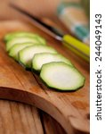 zucchini sliced on wooden... | Shutterstock . vector #244049143