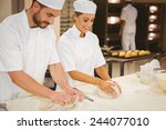 team of bakers kneading dough... | Shutterstock . vector #244077010