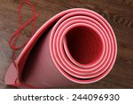 rolled red yoga mat on the...   Shutterstock . vector #244096930