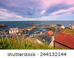 the harbour and village at st.... | Shutterstock . vector #244132144