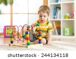 kid boy plays with educational... | Shutterstock . vector #244134118