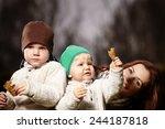 mother and boys in garden | Shutterstock . vector #244187818