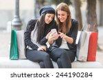 happy women with smart phone... | Shutterstock . vector #244190284