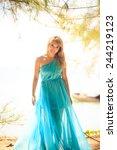 beautiful blonde woman play... | Shutterstock . vector #244219123