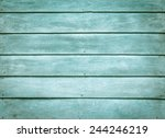 green painted wood plank wall... | Shutterstock . vector #244246219