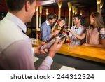 bartender mixing up a cocktail... | Shutterstock . vector #244312324