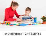 mother playing with her son in  ... | Shutterstock . vector #244318468