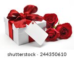 Stock photo bouquet of red roses and gift box with a blank card on white background 244350610