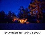 Tourists Around The Campfire A...