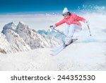 A female skier on the piste in...