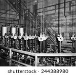 Small photo of The vertical safety rods and the cables that support them at the top of the atomic pile of a reactor at the Manhattan Project Hanford site. February 1945.