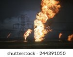 Kuwaiti oil wells set on fire by retreating Iraqi forces during Operation Desert Storm darken the sky with smoke. Mar. 25 1991