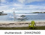seaplane next to beach at... | Shutterstock . vector #244429600